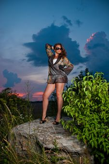 Sunset Rock Woman Royalty Free Stock Images