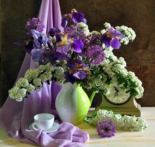 Still Life With Lilac Taffies And White Flowers Stock Images