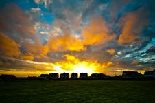 Free Colourful Sunset With Houses And Field Stock Photography - 15440532