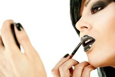 Free Woman Applying Lipstick Stock Image - 15440761