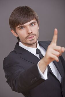 Businessman Pointing With Finger Stock Images