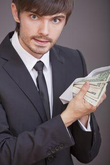 Free Businessman Holding Dollars In Envelope Royalty Free Stock Photo - 15441785