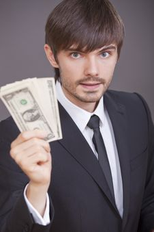 Businessman With Dollars In The Hand Royalty Free Stock Photos