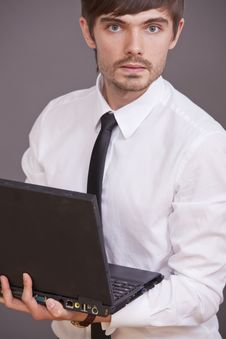 Free Businessman Holding Laptop Computer Royalty Free Stock Photos - 15441888