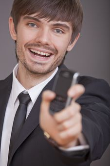 Laughing Businessman Showing Cell Phone Stock Photo