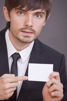 Free Businessman Pointing On Blank Visit Card Royalty Free Stock Photography - 15441987