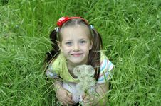 The Girl In A Grass Royalty Free Stock Photo