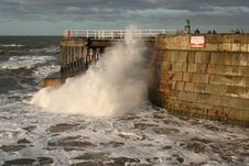 Free Wave Crashing Under Whitby Pier Royalty Free Stock Photo - 15443135