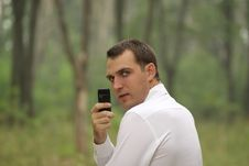Young Attractive Man Calling By Phone Stock Photography