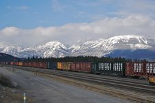 Coloured Freight Trains In Mountain 2 Stock Image