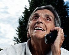 Eldery Senior Woman On Cordless Phone Stock Image