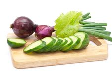 Green Cucumber Slices With Red Onion Stock Photography