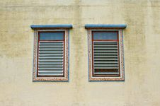 Free Two Traditional Windows On The Yellow Wall Stock Photos - 15450123