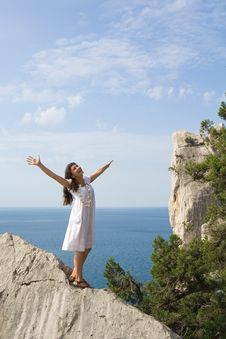 Free Happy Young Girl On The Rocks Stock Photo - 15451520