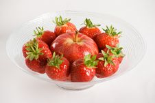 Strawberries And Apple In A Glass Bowl Stock Photos