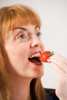 Free Woman Eating Strawberry Stock Photos - 15453563