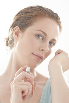 Woman Spraying Perfume Stock Image