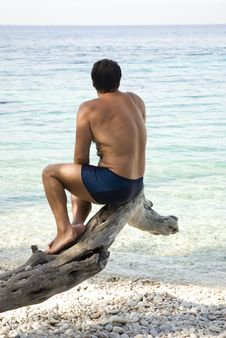 Free Man Sitting On Beach Stock Image - 15455771