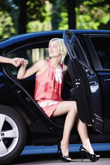 Free A Beautiful Girl Comes Out Of The Car Stock Photos - 15456943