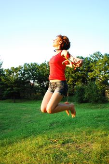 Free Happy Woman Jumping On Grass Stock Photo - 15458260