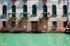 Facade Of Old Venetian House Standing In Water Royalty Free Stock Photography