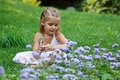 Free A Little Girl Sitting In The Meadow Stock Photo - 15460530