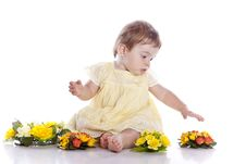 Portrait Of Lovely Baby Playing With Flower Royalty Free Stock Photography