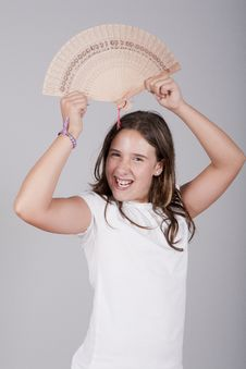 Girl With Fan On Her Hand And Smiling Stock Photography