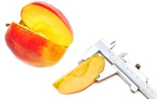 Free Slice Of Red Apple Is Measured Stock Photo - 15466010