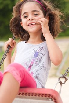 Free Lovely Girl On A Swing In The Park Royalty Free Stock Image - 15468526