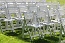 Free Empty Chairs On Yard Grass Stock Photography - 15469822