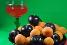 Apricots And Plums Stock Photos