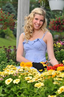 Free Young Beautiful Blond Girl At The Garden Stock Photos - 15474373