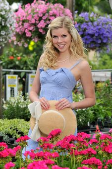 Free Young Beautiful Blond Girl At The Garden Stock Photography - 15474402