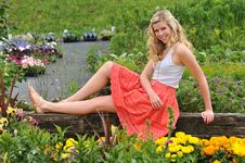 Free Young Beautiful Blond Girl At The Garden Stock Photos - 15474433