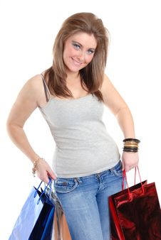 Free Pretty Young Woman Posing With Shopping Bags Stock Photo - 15476230