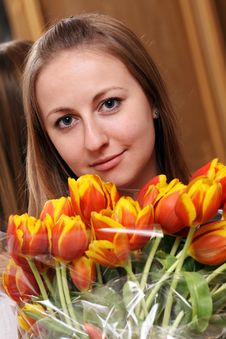 Free Blonde Holding Bunch Of Flowers Stock Image - 15478461