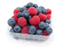 Raspberry And A Blueberry Stock Image