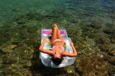 Free A Girl Sunbathing On A Mattress Royalty Free Stock Photography - 15488667