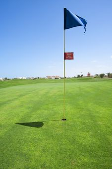 Free Flag On A Golf Course Green Stock Photo - 15492600