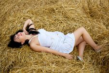 Free Woman Is Laying On A Straw Stock Image - 15496571