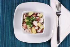 Octopus With Potatoes Served In A White Dish Royalty Free Stock Photos