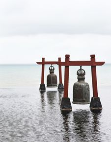 Two Old Large Bells In Water Royalty Free Stock Images