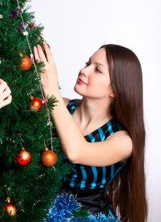 Girl Near Christmas Fir Tree Royalty Free Stock Photos
