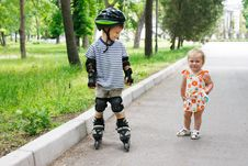 Free Girl Looking Young Boy Rollerskating Royalty Free Stock Photos - 15499528