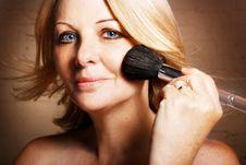 Woman Applying Blusher Stock Photos