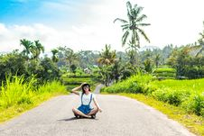 Free Tropical Portrait Of Young Happy Woman With Straw Hat On A Road With Coconut Palms And Tropical Trees. Bali Island. Royalty Free Stock Images - 154962839