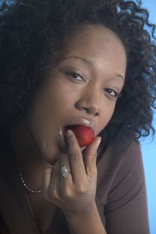 Free Pretty Girl Eating A Strawberry Stock Image - 1550471