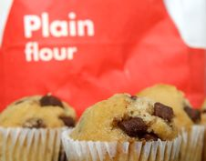 Free Golden Chocolate Chip Muffins Baked In The Kitchen Stock Photo - 1551060