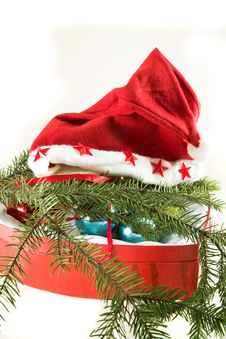 Christmas Cap On The Box With Decorations Stock Images